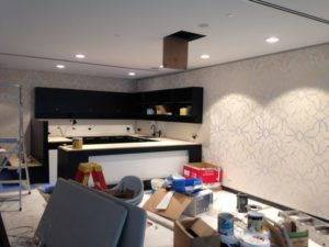Wallpaper in a kitchen during its installation